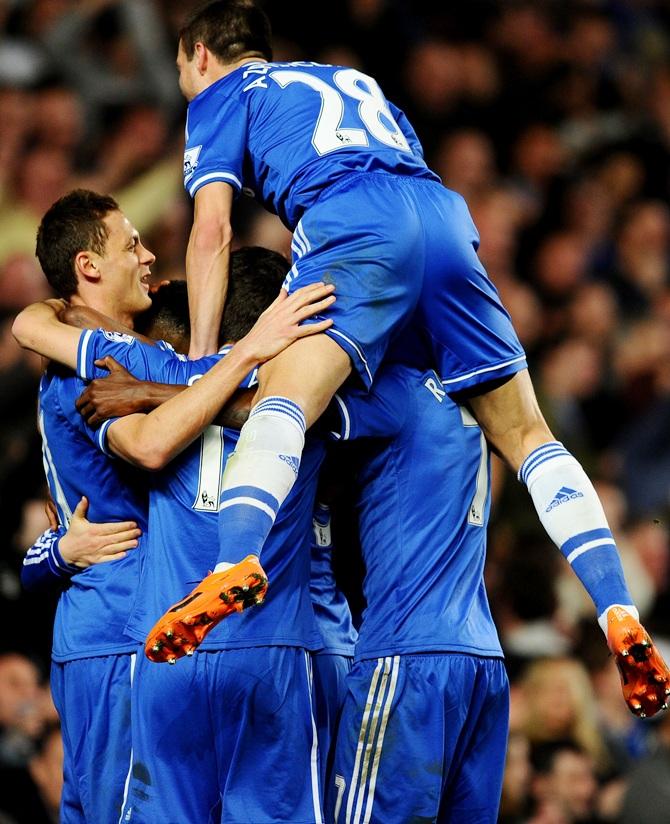 Eden Hazard of Chelsea celebrates with teammates after scoring.