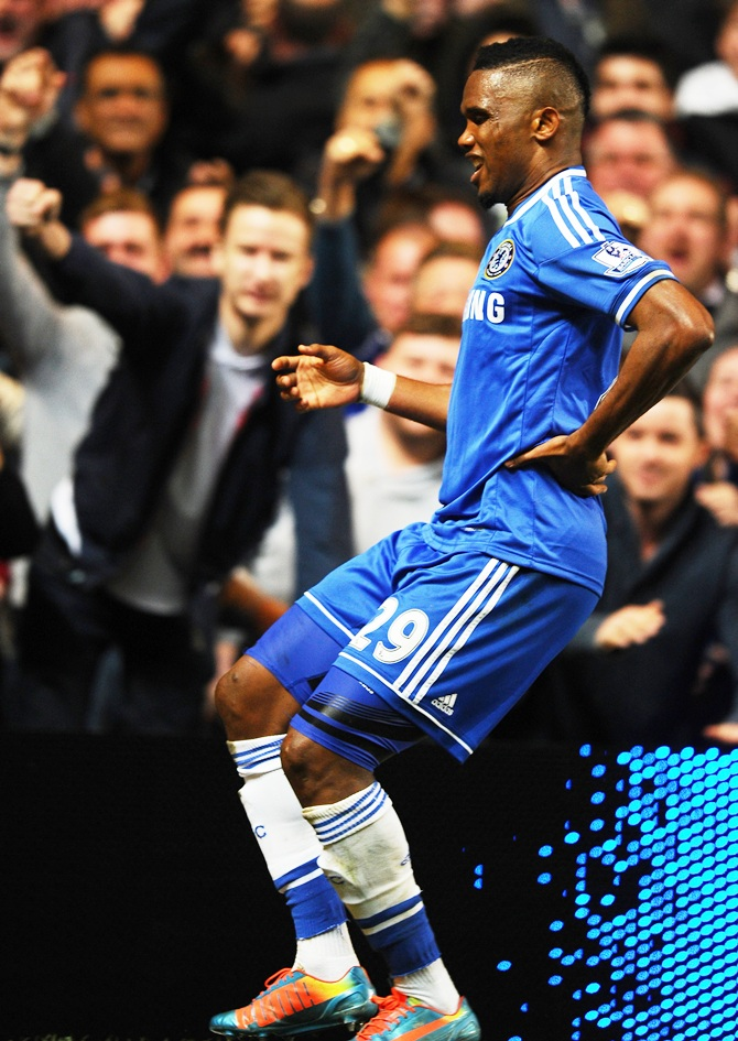 Samuel Eto'o of Chelsea does an 'Old Man' celebration after scoring his team's first goal.