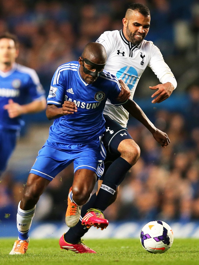 Ramires of Chelsea and Sandro of Spurs battle for the ball.