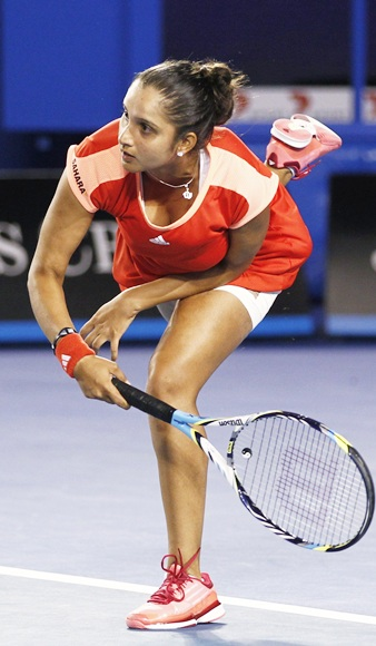 Sania Mirza of India serves