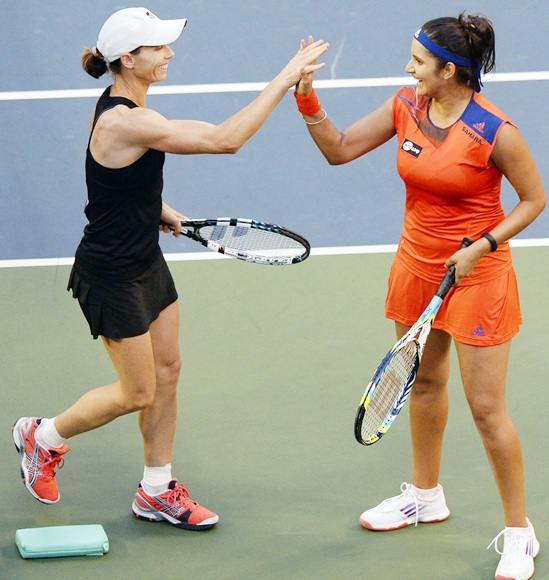 Sania Mirza, right, with Cara Black
