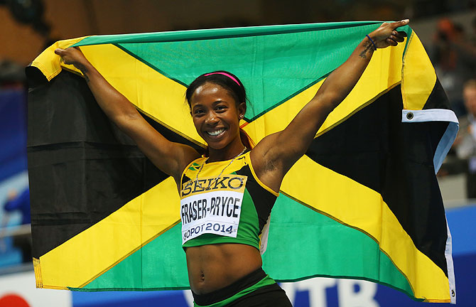 Shelly-Ann Fraser-Pryce of Jamaica celebrates winning the gold medal in the Women's 60m