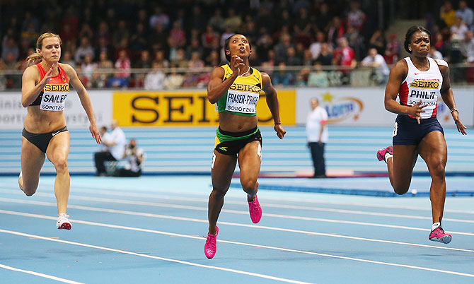 Shelly-Ann Fraser-Pryce of Jamaica competes on way to winning the gold medal, beating Verena Sailer (left) of Germany and Asha Philip of Great Britain in the Women's 60m final during day three of the IAAF World Indoor Championships on Sunday
