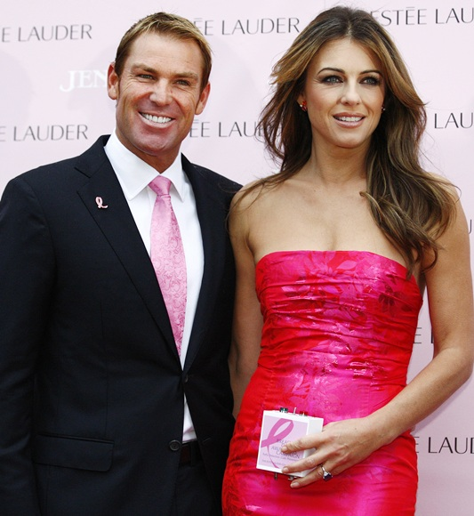Shane Warne stands next to actress and model Liz Hurley