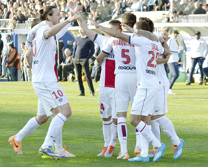 Paris Saint-Germain's Zlatan Ibrahimovic (left) celebrates with teammates after scoring