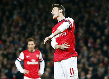 Arsenal's Mesut Ozil reacts after missing a penalty against Bayern Munich during their Champions League match last month