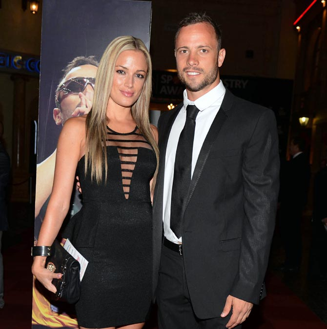 Oscar Pistorius (R) and his girlfriend Reeva Steenkamp pose for a picture in Johannesburg, on February 7, 2013
