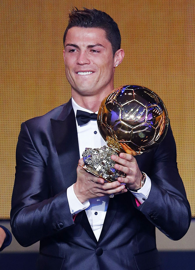 Portugal's Cristiano Ronaldo holds his trophy after being awarded the FIFA Ballon d'Or 2013 in Zurich