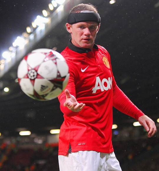 Wayne Rooney of Manchester United looks on