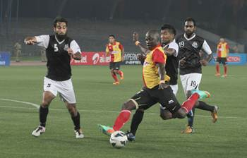 East Bengal's Chidi Edeh is tackled by a host of Mohammedan Sporting defenders as he breaks into the box