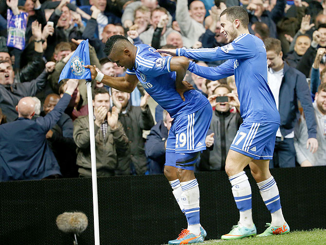Chelsea's Samuel Eto'o (left) celebrates with teammate Eden Hazard after scoring against Tottenham Hotspur during their English Premier League match at Stamford Bridge in London