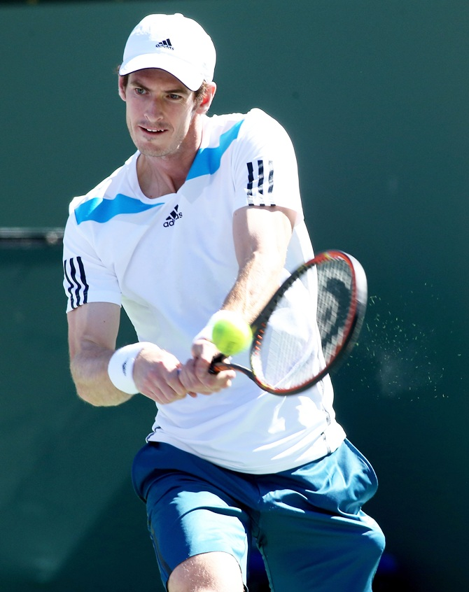 Andy Murray of Great Britain hits a return
