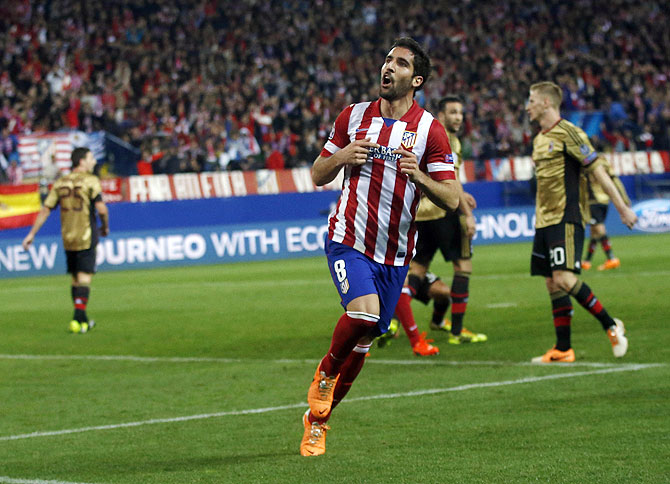Atletico Madrid's Raul Garcia celebrates scoring against AC Milan on Tuesday
