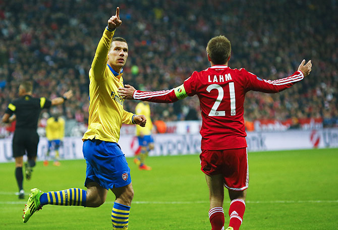 Arsenal's Lukas Podolski (left) celebrates after scoring against Bayern Munichon Tuesday