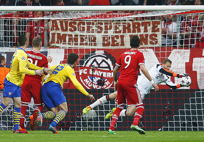 Bayern Munich's Manuel Neuer (right) saves a shot by Arsenal's Oliver Giroud on Tuesday