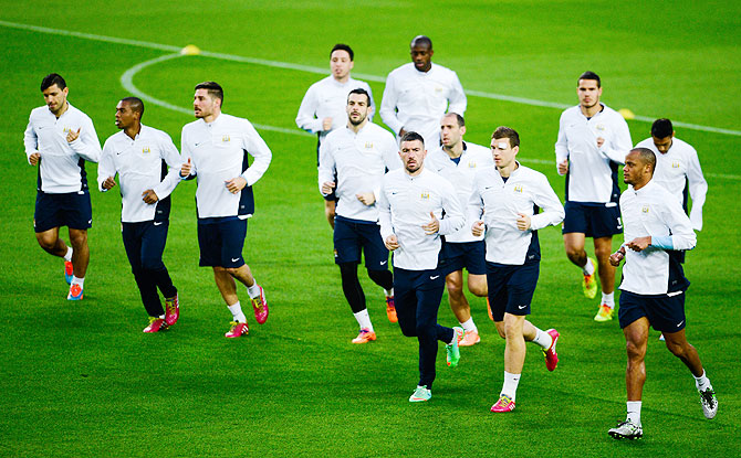 Manchester City FC players warm up during a training session ahead the UEFA Champions League Round of 16 second leg match against FC Barce