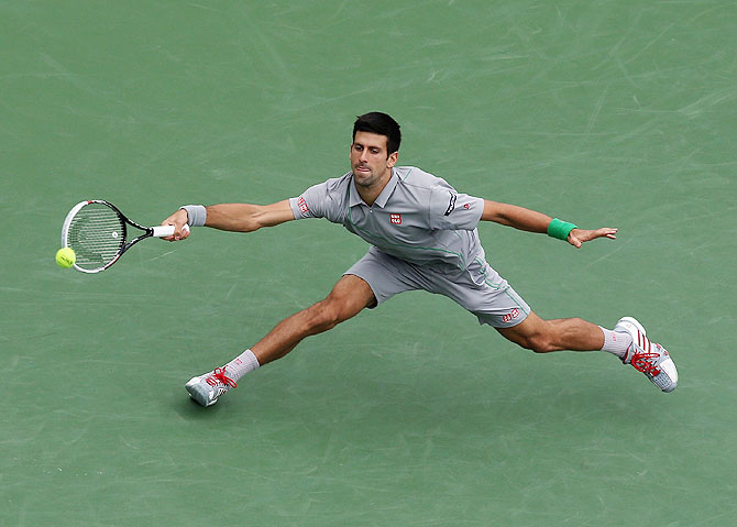 Novak Djokovic of Serbia lunges to play a return against Alejandro Gonzalez of Colombia at Indian Wells Tennis Garden on Tuesday