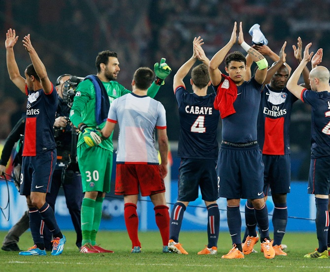 PSG players celebrate victory after the UEFA Champions League Round of 16 second leg match against Bayer Leverkusen