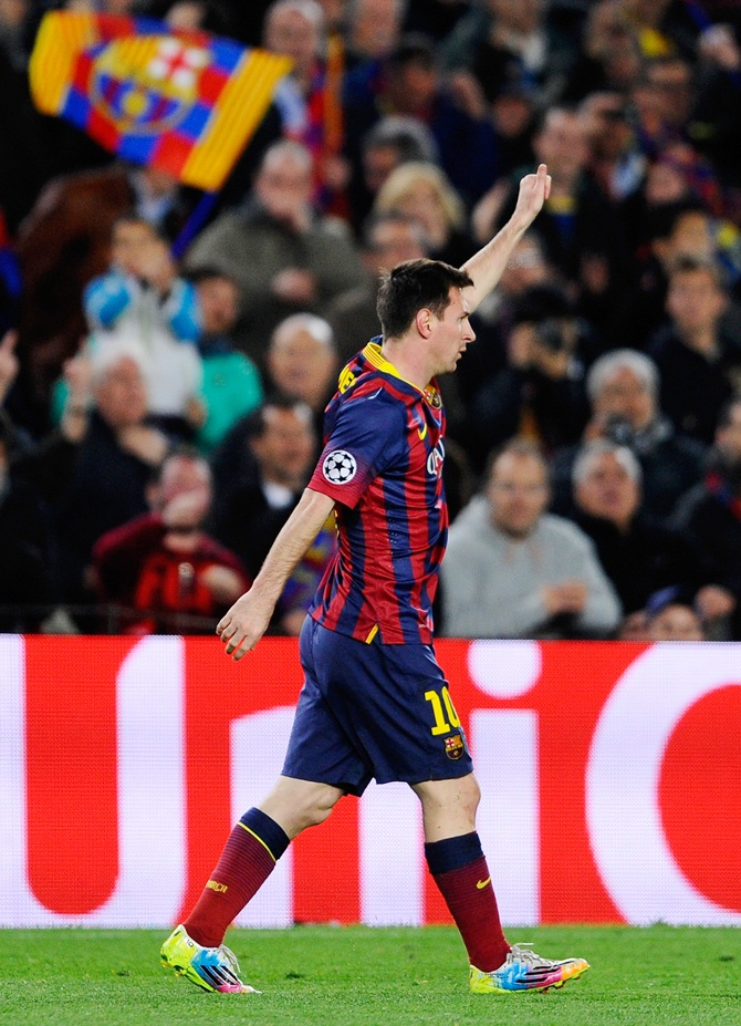Lionel Messi of Barcelona celebrates after scoring the opening goal