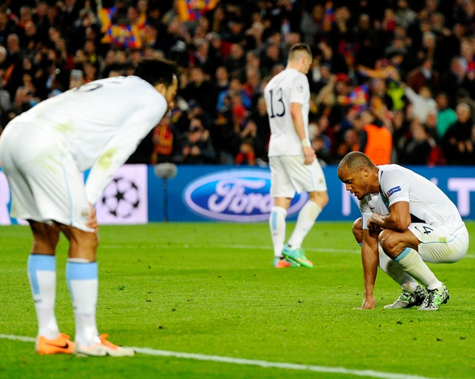 A dejected Manchester City captain Vincent Kompany, right.