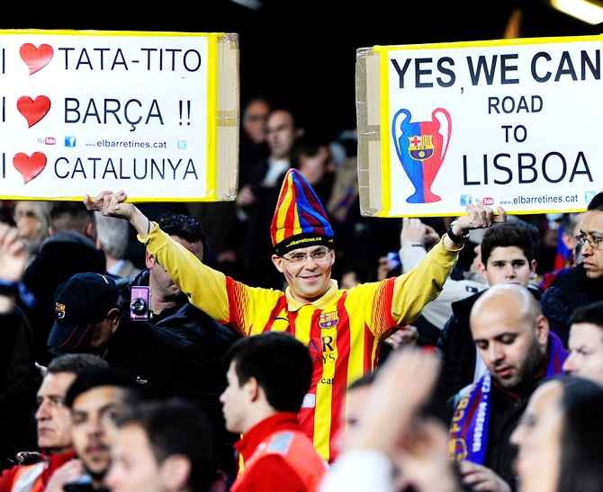 A Barcelona fan cheers on his team during the UEFA Champions League match
