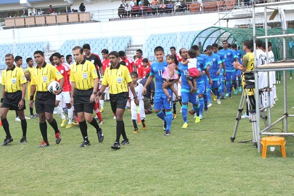Sunil Chhetri (right) leads the Indian squad out against Bangladesh
