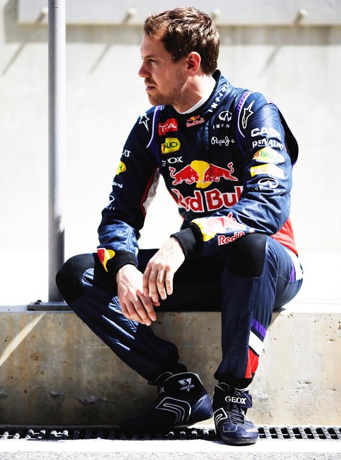 Sebastian Vettel of Germany and Infiniti Red Bull Racing poses