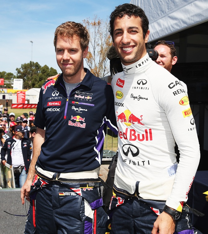 Sebastian Vettel, left, with Daniel Ricciardo