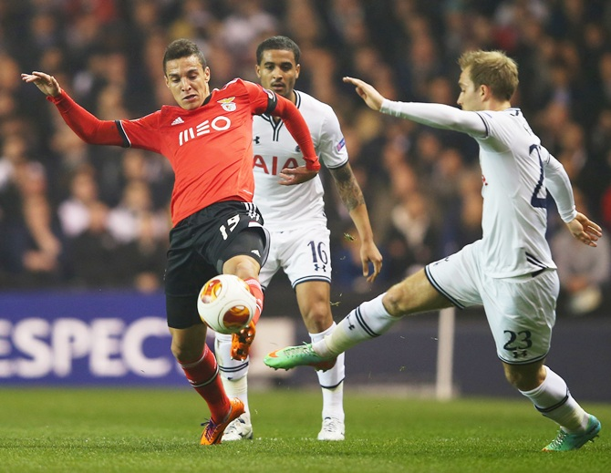Rodrigo Moreno of Benfica battles with Christian Eriksen of Tottenham Hotspur during the UEFA Europa League match