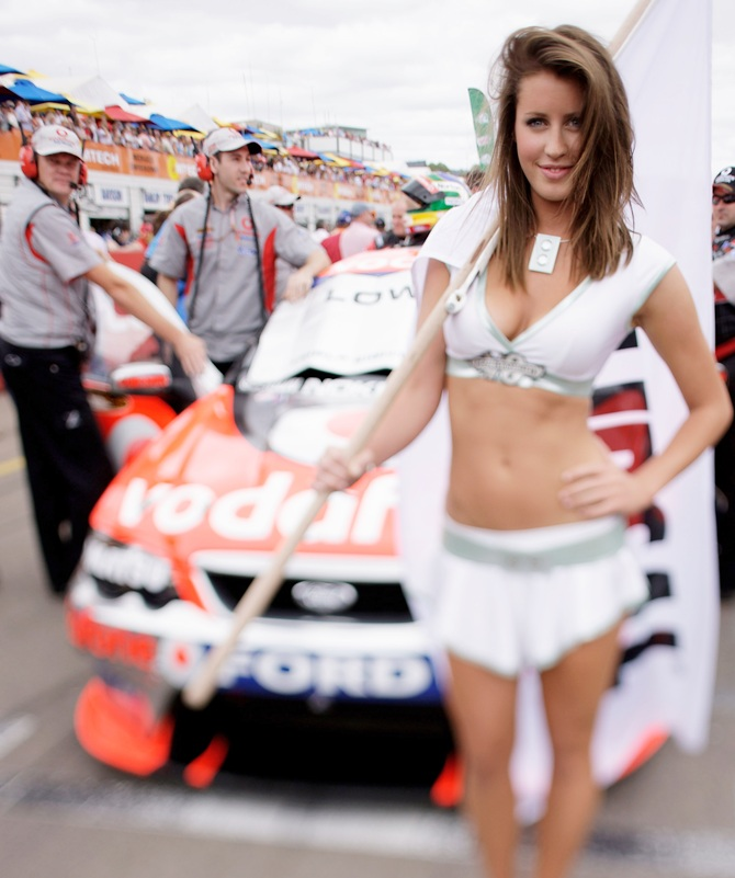 A grid girl is seen on the grid prio to the start of race