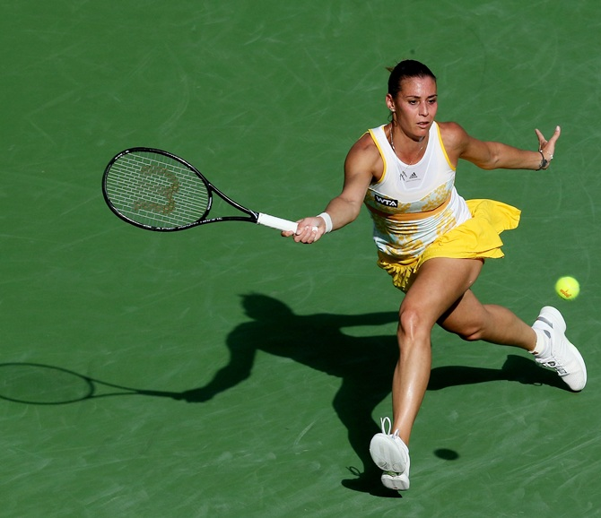Flavia Pennetta of Italy hits a return to Sloane Stephens
