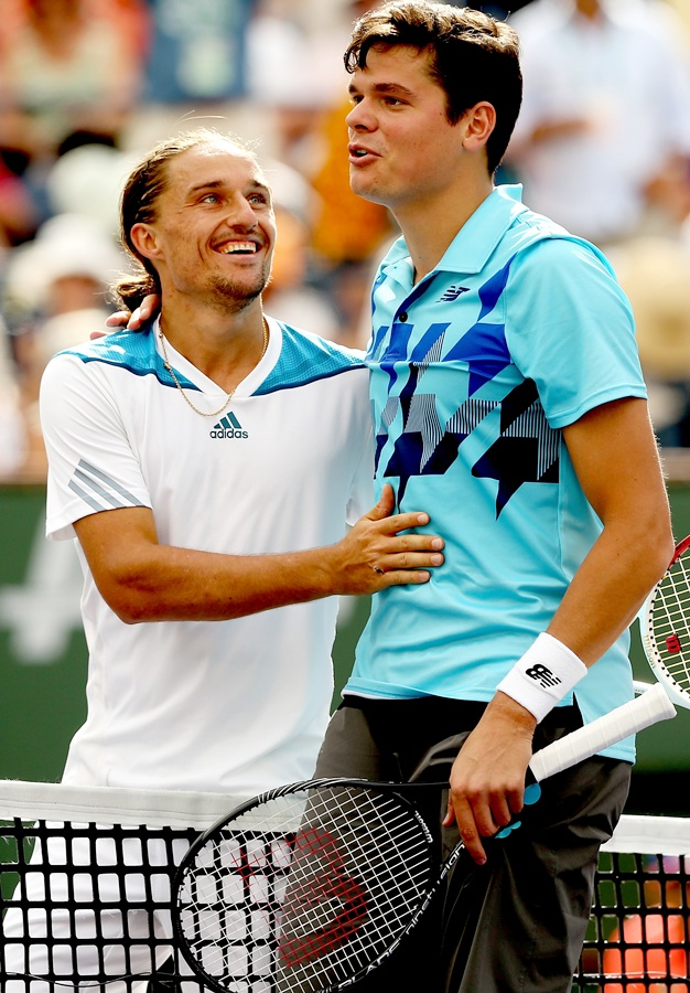 Alexandr Dolgopolov of Ukraine is congratulated by Milos Roanic of Canada