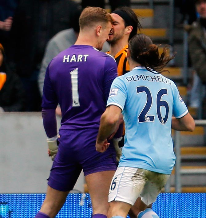 Manchester City goalkeeper Joe Hart (left) clashes with Hull City's George Boyd