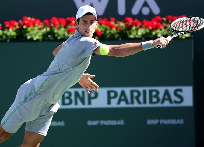 Novak Djokovic of Serbia hits a return