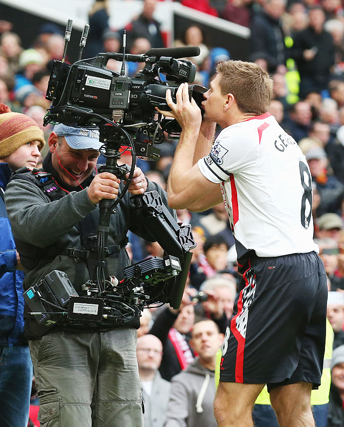 Steven Gerrard of Liverpool kisses the steadicam as he celebrtaes scoring the second goal against Manchester United during their English Premier League match at Old Trafford on Sunday