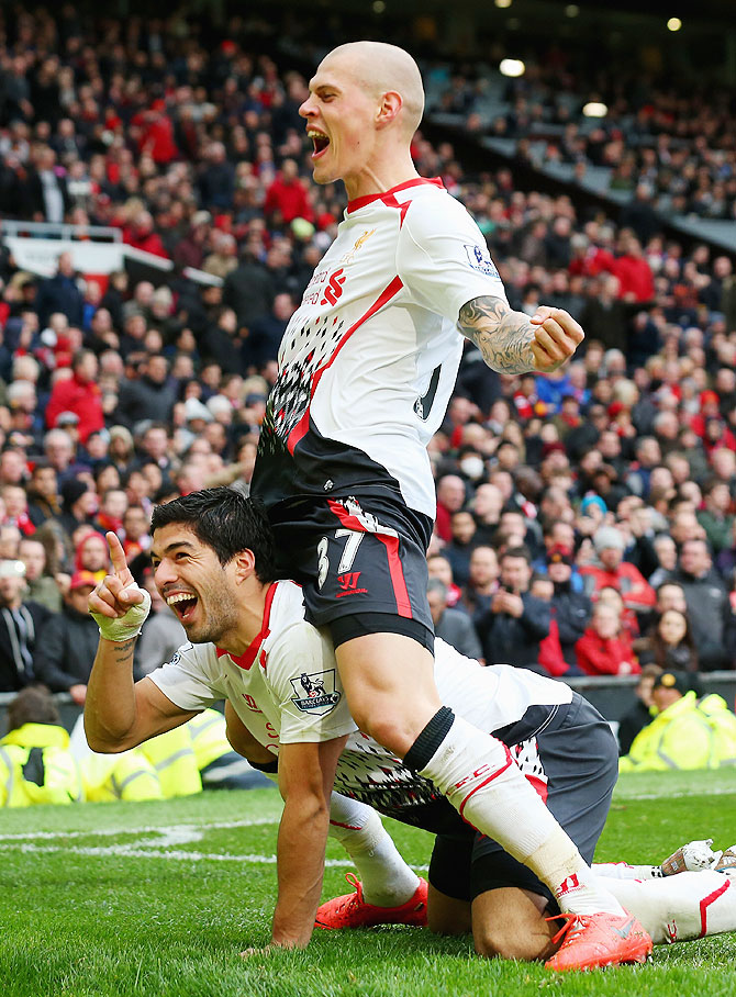 Luis Suarez of Liverpool celebrates with Martin Skrtel after scoring against Manchester United on Sunday