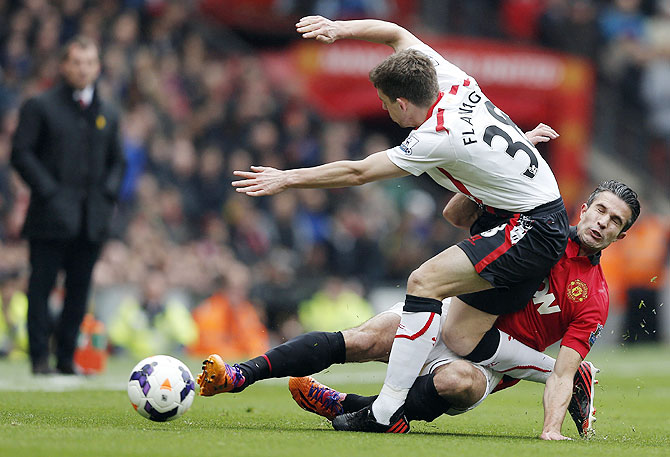 Manchester United's Robin van Persie (right) challenges Liverpool's Jon Flanagan on Sunday