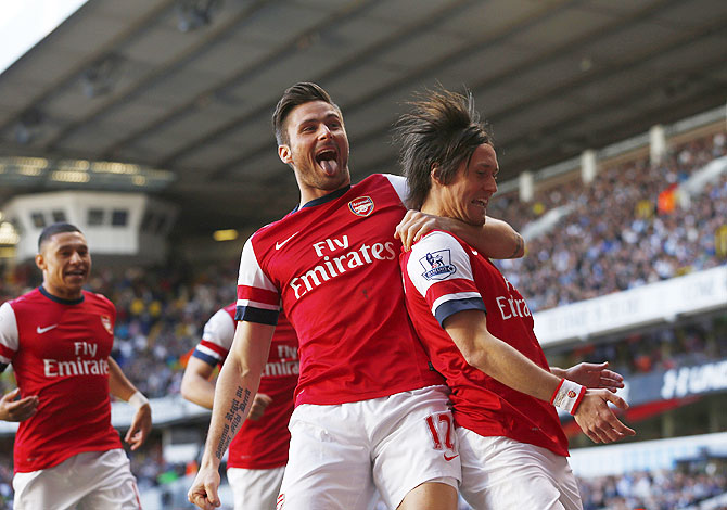 Arsenal's Tomas Rosicky (right) celebrates his goal against Tottenham Hotspur with Olivier Giroud on Sunday