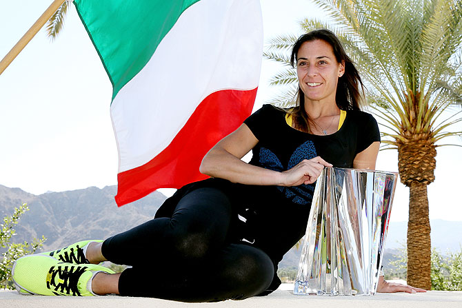 Flavia Pennetta of Italy poses for photographers after defeating Agnieszka Radwanska of Poland during the final of the BNP Parabas Open at the Indian Wells Tennis Garden in California on Sunday