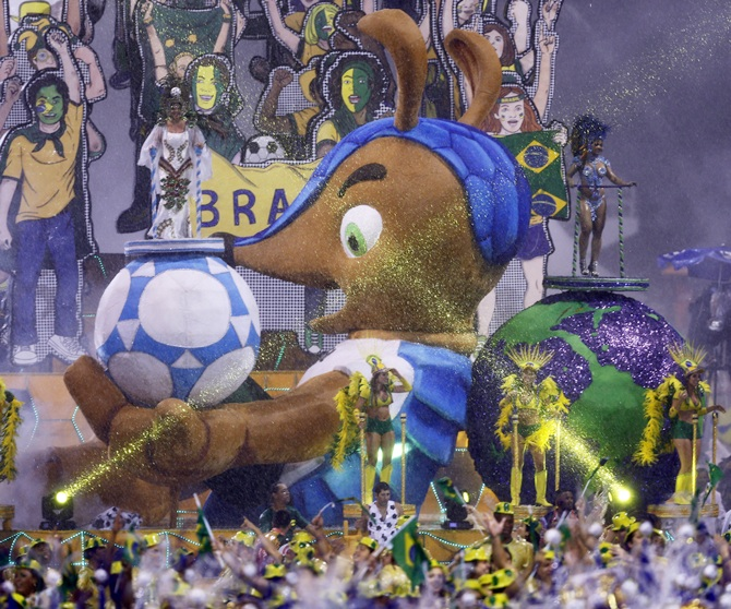 he official mascot of the FIFA 2014 World Cup, Fuleco the Armadillo, is seen on a float