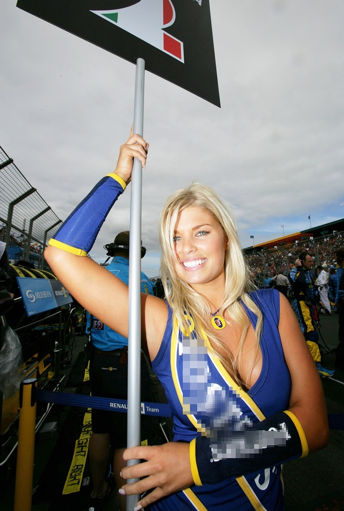 A grid girl poses before the Australian Formula One Grand Prix April 02, 2006