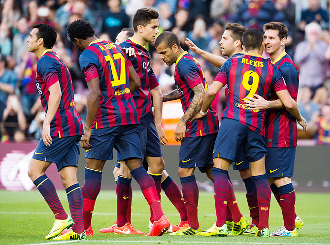 FC Barcelona players celebrate after scoring a goal