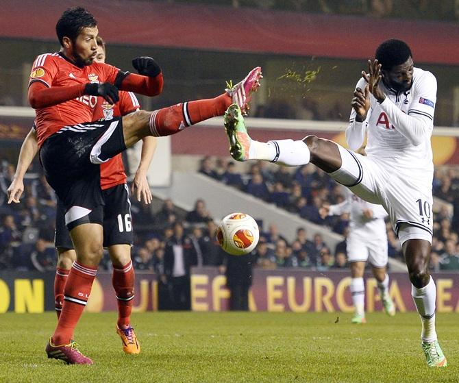 Tottenham Hotspur's Emmanuel Adebayor challenges Benfica's Ezekiel Garay
