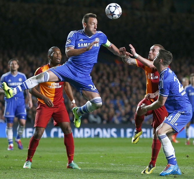 Chelsea's John Terry, centre, heads the ball clear during their Champions League match against Galatasaray