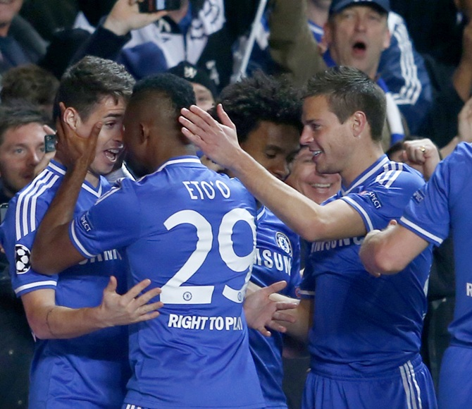 Chelsea's Samuel Eto'o, centre, celebrates scoring against Galatasaray with team-mates Oscar, left, and Cesar Azpilicueta