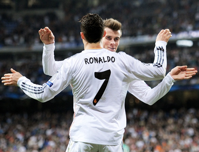 Cristiano Ronaldo of Real Madrid celebrates with teammate Gareth Bale