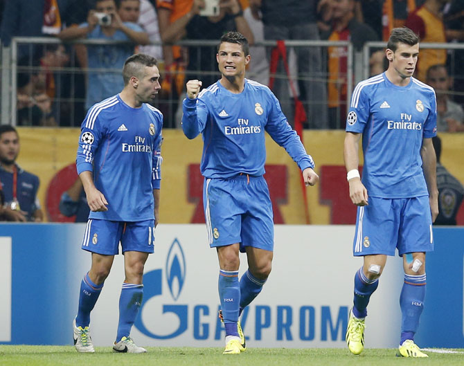 Real Madrid's Cristiano Ronaldo, centre, celebrates with team mates Daniel Carvajal,left, and Gareth Bale