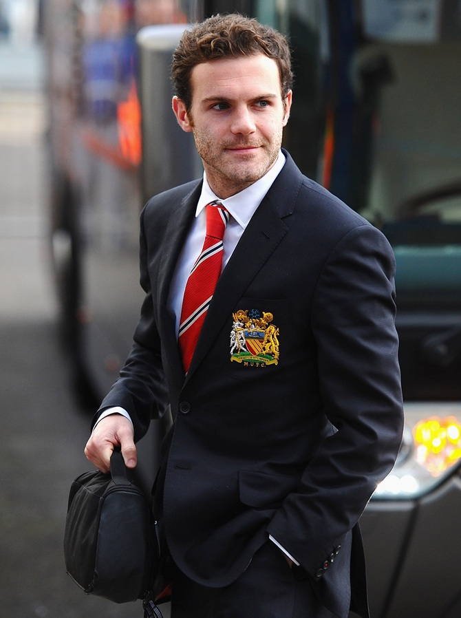 Juan Mata of Manchester United steps off the team bus