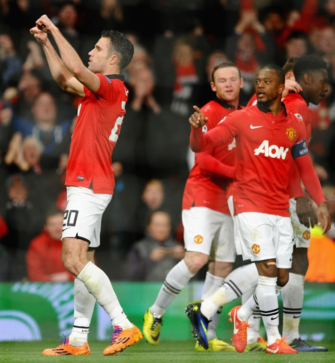Robin van Persie of Manchester United celebrates scoring the goal against Olympiacos FC at Old Trafford