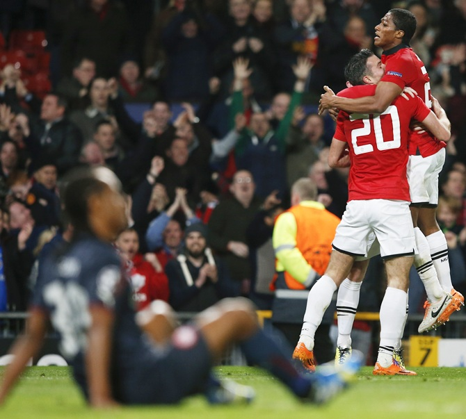 Manchester United's Antonio Valencia, right, and Robin van Persie celebrate
